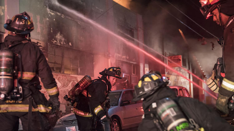 Firefighters battle a warehouse fire in Oakland that claimed the lives of 36 people during a concert