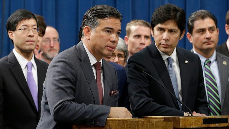 Gov. Jerry Brown signed climate legislation from Assemblyman Rob Bonta, center. (Rich Pedroncelli / Associated Press)