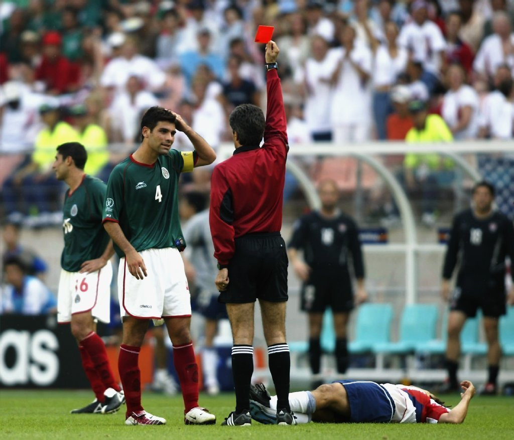 Rafael Marquez of Mexico is sent off for a foul on Cobi Jones during a World Cup match in South Korea on June 17, 2002.