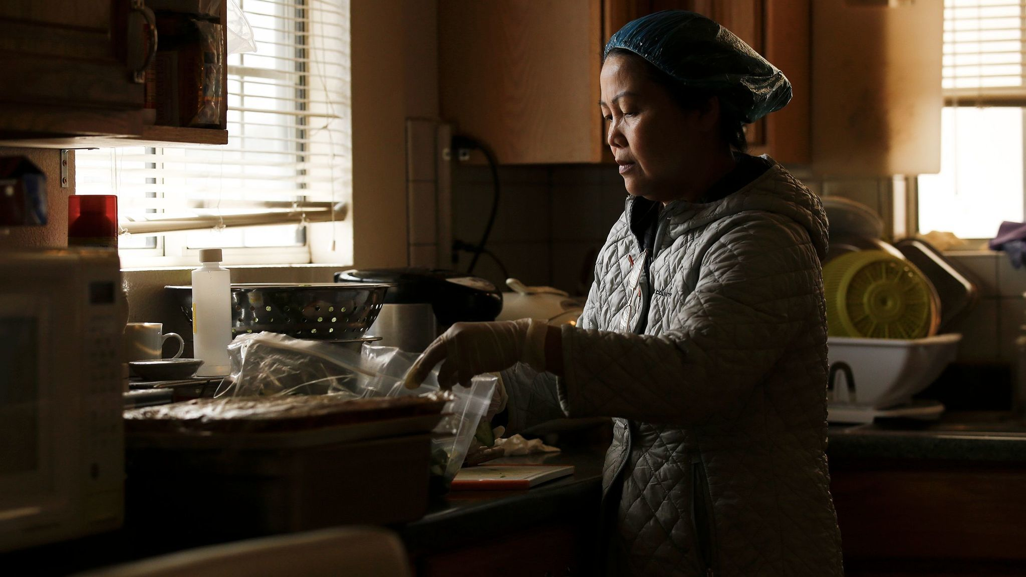 "Hue Phan is one of many cooks in Little Saigon who work long hours in their homes to provide a type of service known as ""com thang,"" literally translated as ""monthly rice."""