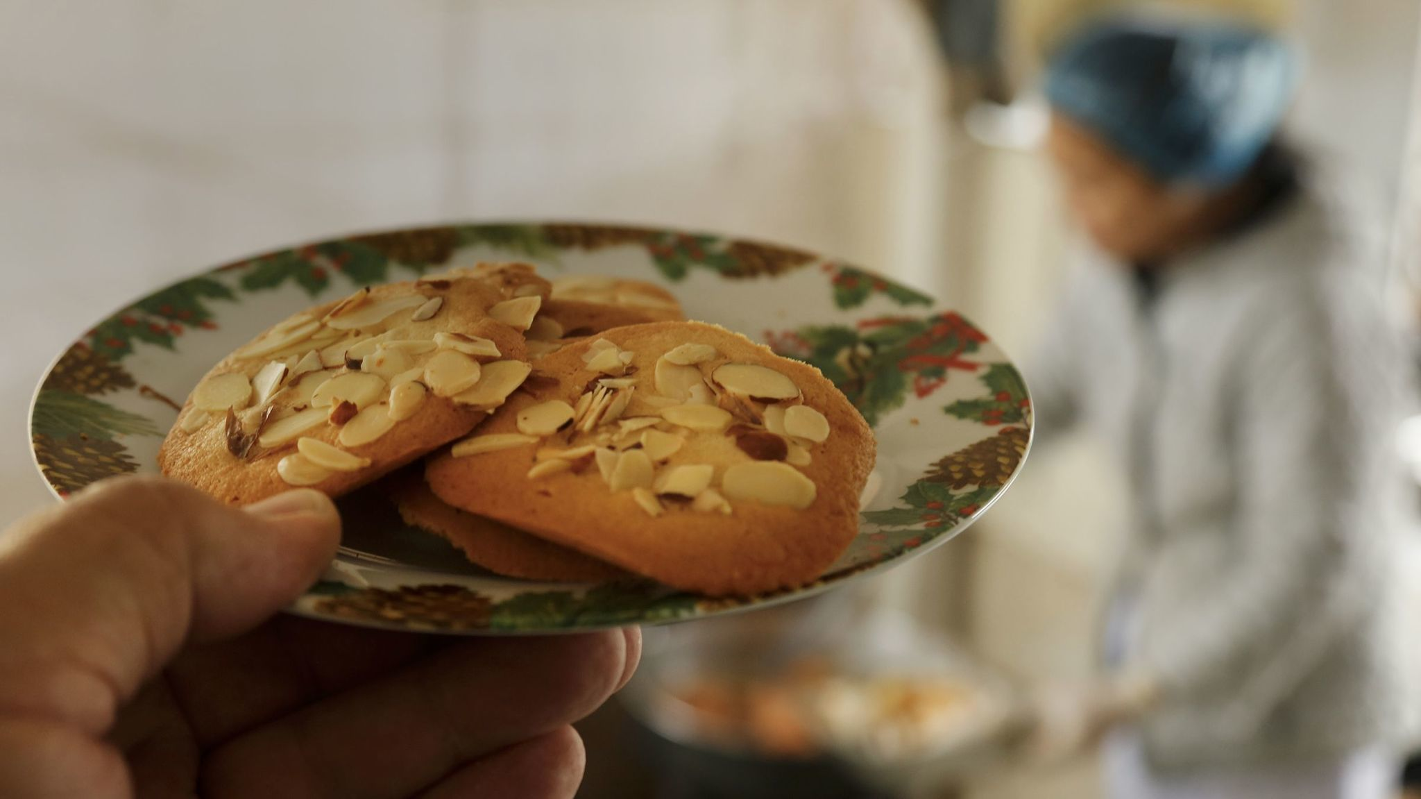 Crispy almond cookies add to Hue Phan's repertoire, baked before the meals are delivered..