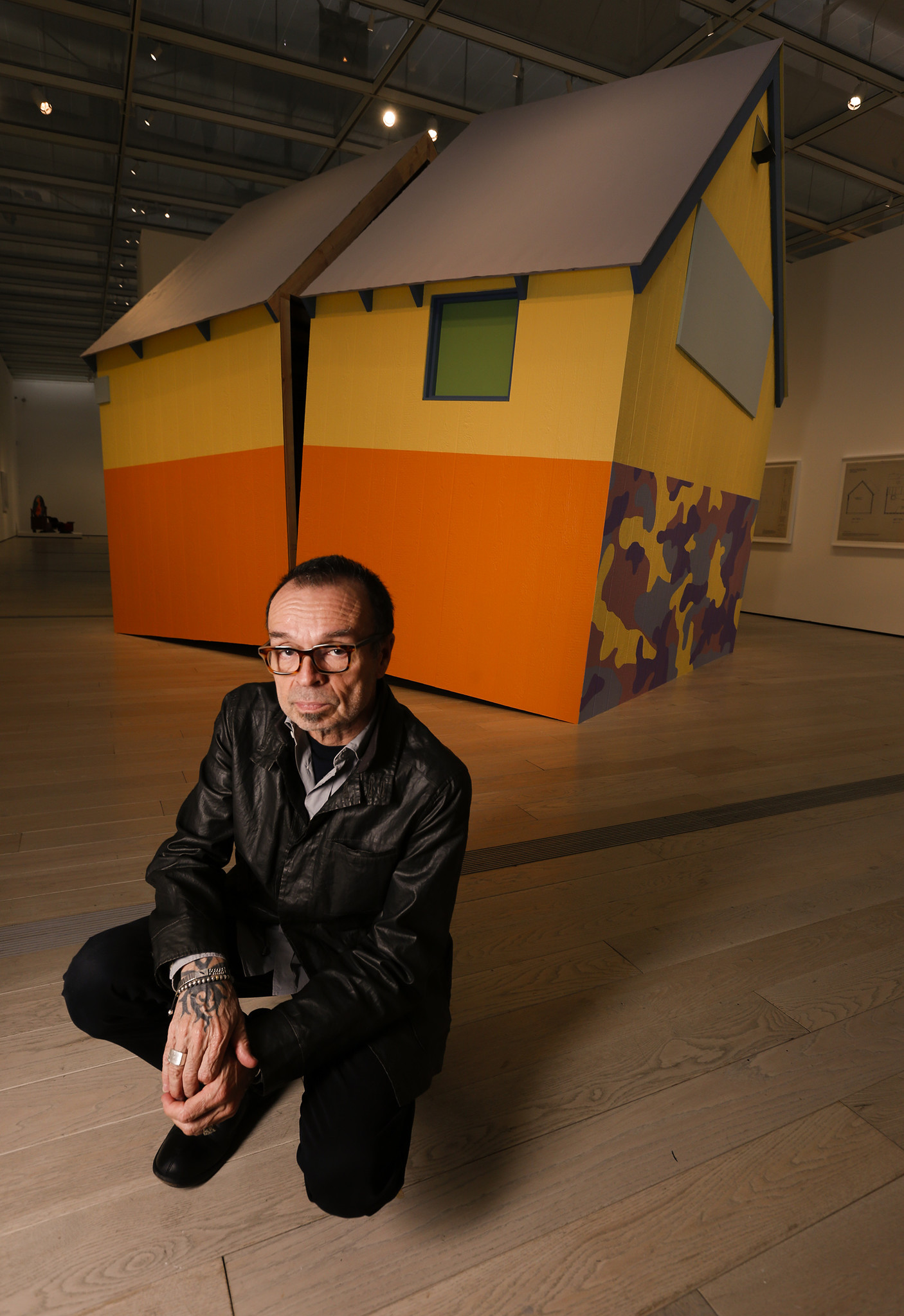 "Artist Daniel Joseph Martinez with his sculpture, ""The House America Built"" (2004/2017), inspired by the Unabomber cabin."