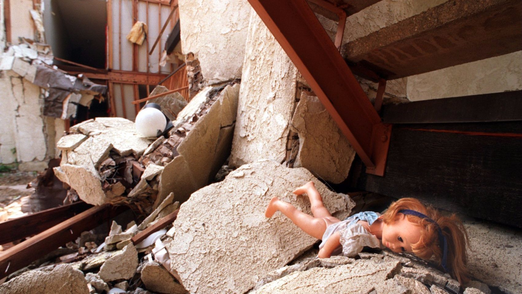 A doll lies in the rubble of the Northridge Meadows apartment, where 16 bodies were found after 1994 Northridge earthquake.