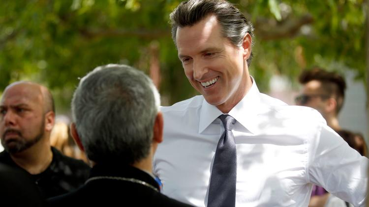 Lt. Gov. Gavin Newsom speaks with participants of a march in Pan Pacific Park in Los Angeles commemorating the 102nd anniversary of the Armenian genocide in April. (Francine Orr / Los Angeles Times)