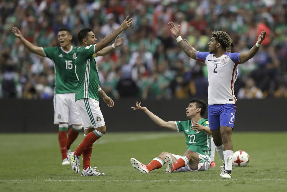 Mexico players react to a foul committed by DeAndre Yedlin of the U.S. (Rebecca Blackwell / Associated Press)