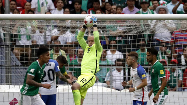 American goalkeeper Brad Guzan grabs the ball after Mexico made a pass into the penalty box Sunday. (Eduardo Verdugo / Associated Press)