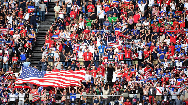 American fans listen to the national anthem before the start of the World Cup qualifier Sunday. (Alfredo Estrella / Associated Press)