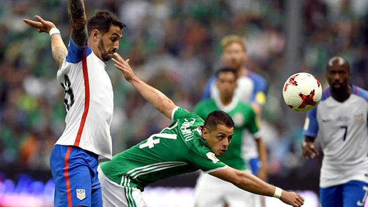 U.S. defender Geoff Cameron pulls up as Mexico forward Javier Hernandez tries to receive a pass. (Alfredo Estrella / AFP / Getty Images)