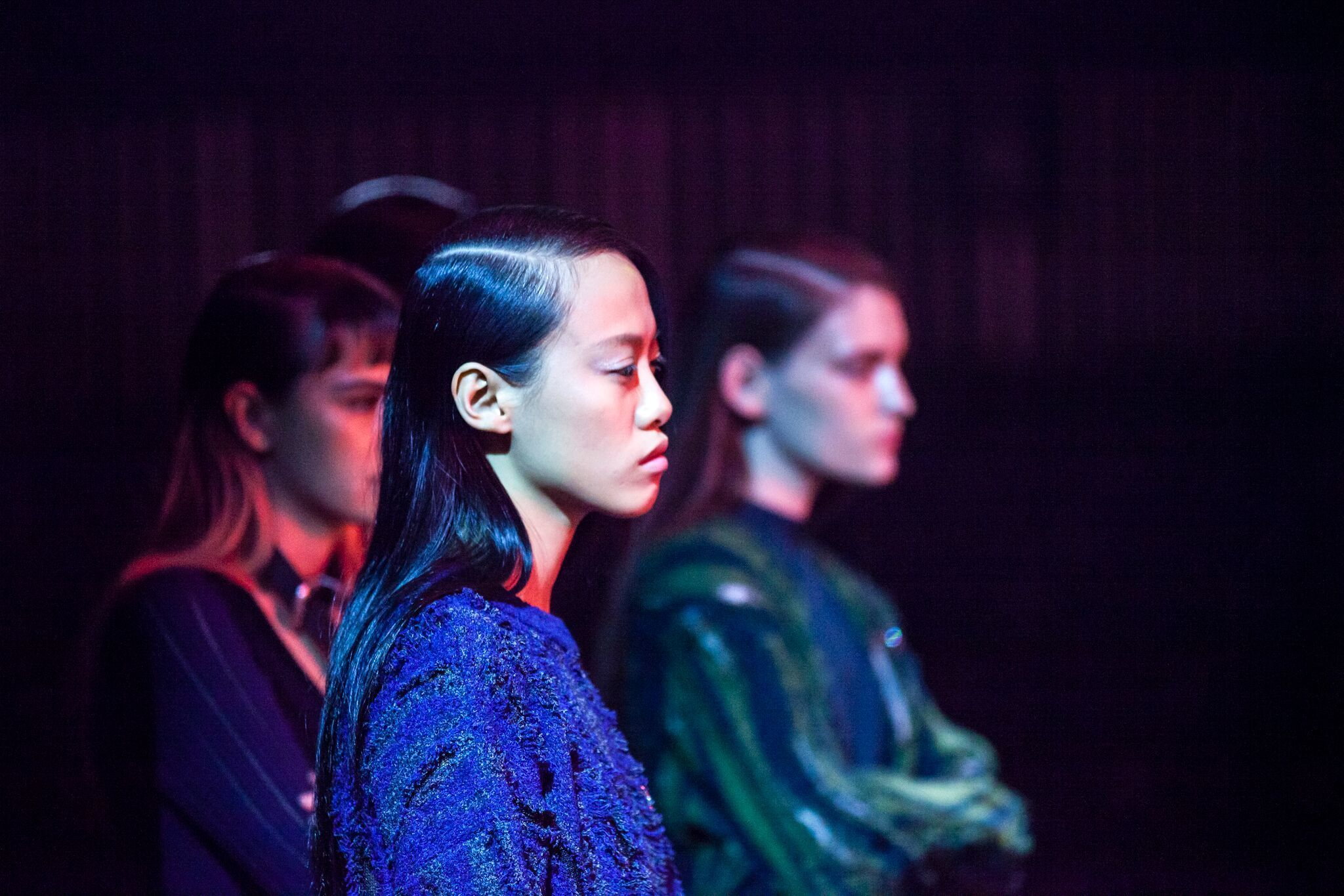 A super-low side part and hair pushed behind the ears are part of the runway looks for Opening Ceremony.