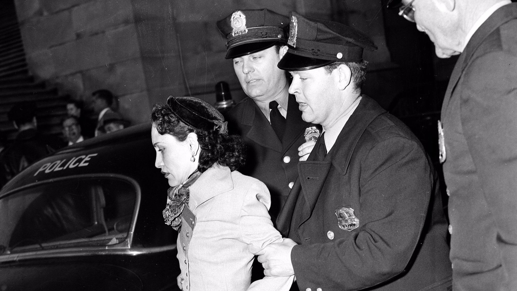 Puerto Rican nationalist Lolita Lebron is led away by police after she and others began shooting in the House chamber at the Capitol in 1954.