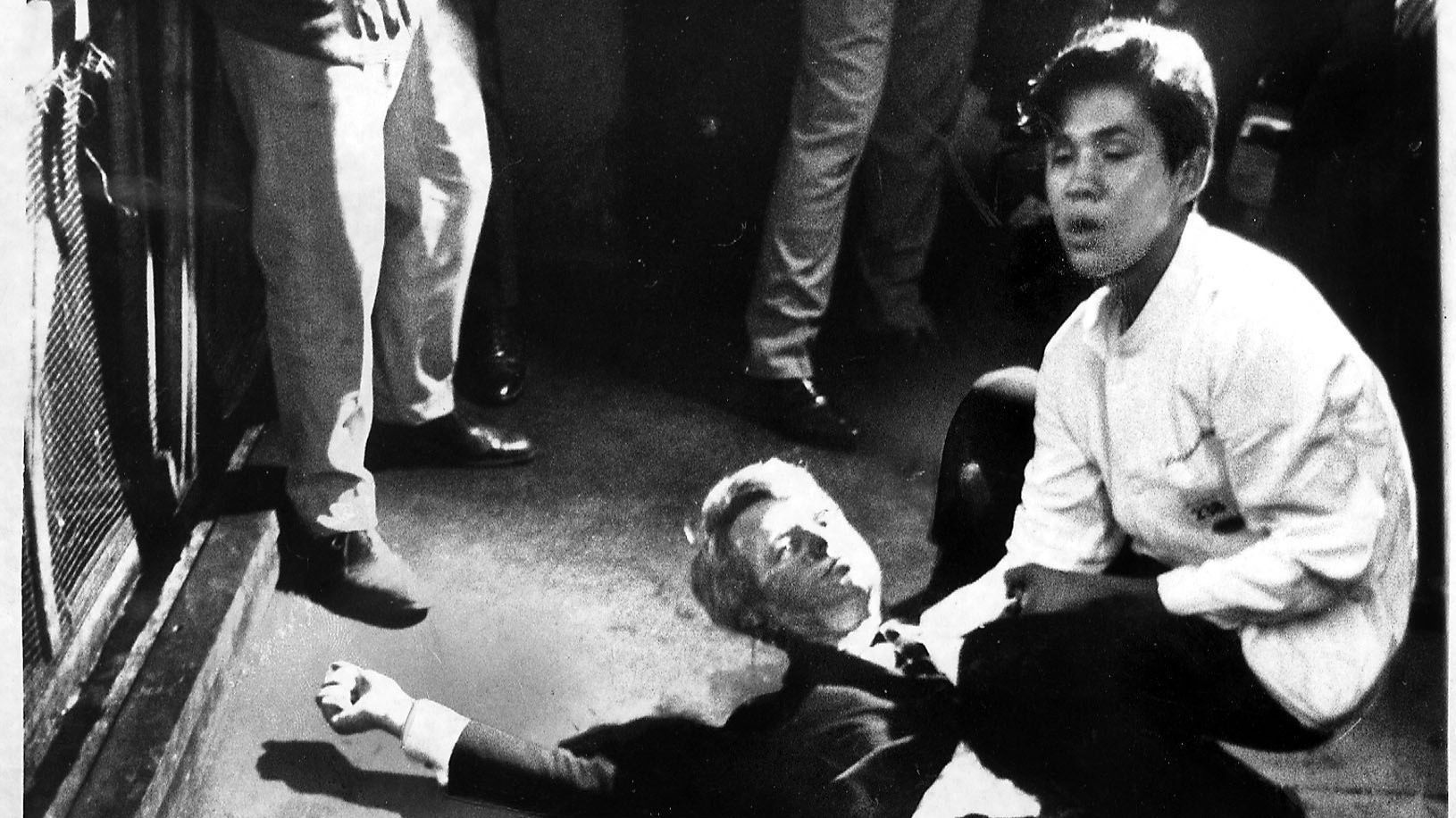 Sen. Robert F. Kennedy lies on the floor of the Ambassador Hotel kitchen cradled by busboy Juan Romero moments after he was shot and mortally wounded in 1968.