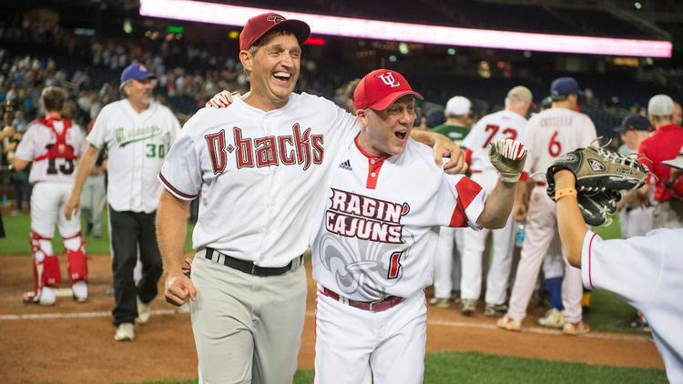 Sen. Jeff Flake (R-Ariz.), left, and House Majority Whip Steve Scalise (R-La.) celebrate after the Republicans' 8-7 victory at the 2016 Congressional Baseball Game. (Tom Williams / CQ Roll Call)