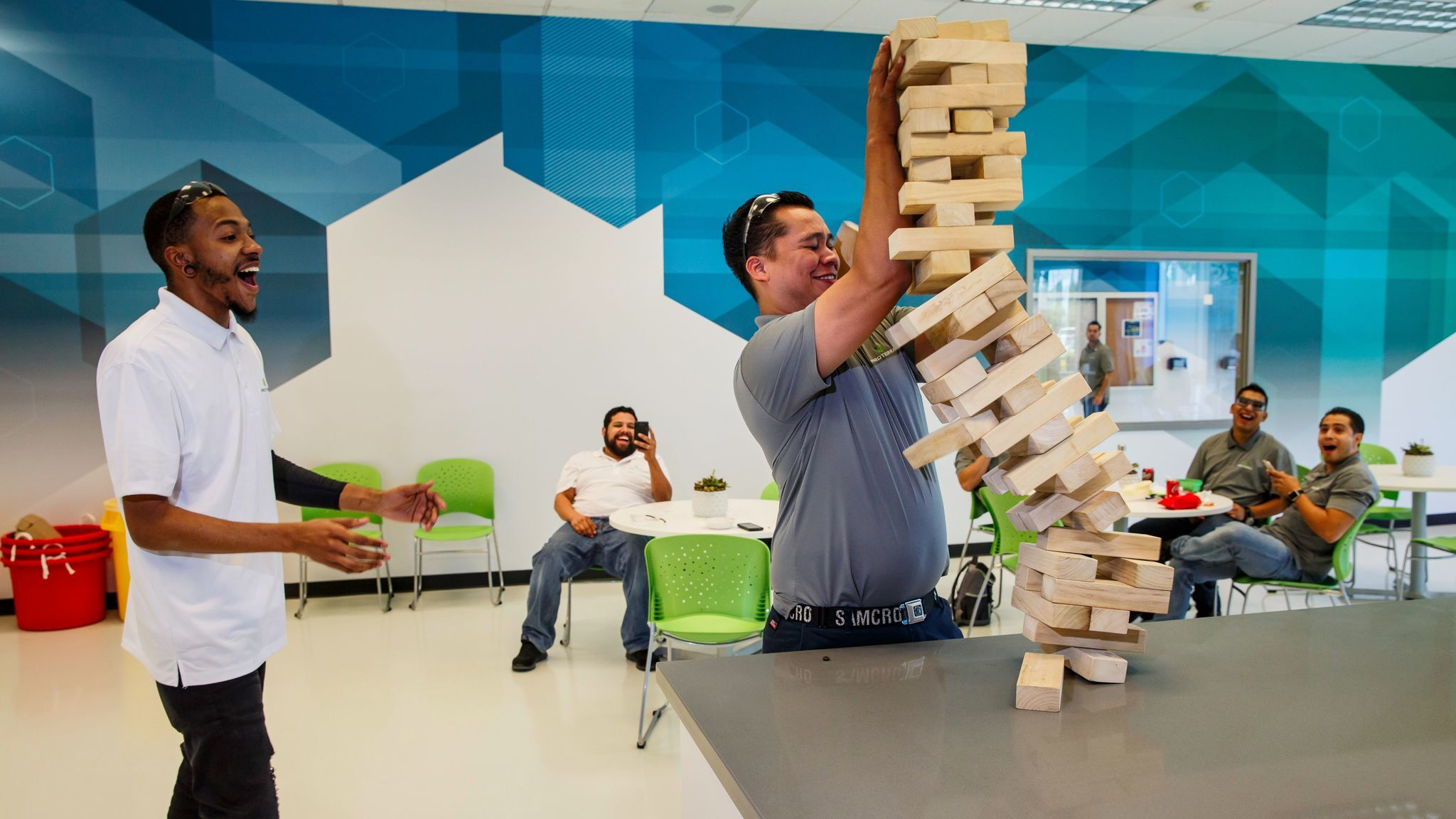 Derik Stone and Manny Almanza play giant Jenga on their lunch break. Proterra gives them 45 minutes.