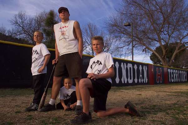 This 2002 photo of the Valaika brothers. All four were baseball draft picks. Chris (center) with brothers Matt, left, Nick, center, Patrick, right. (Brian van der Brug / Los Angeles Times)