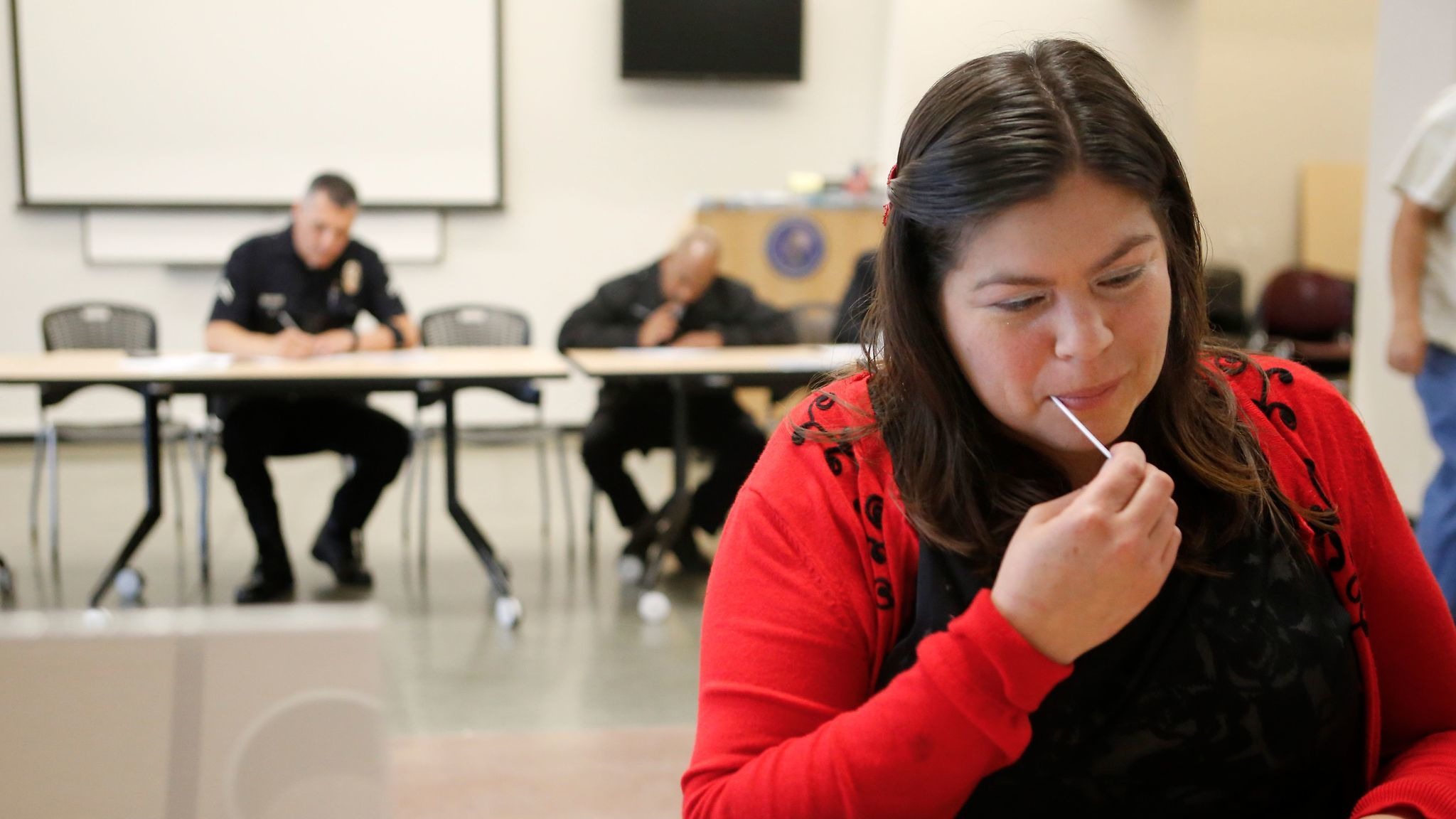 Jacqueline Chilin swabs cells from her cheek that will be tested to determine if she is a match for LAPD Officer Matthew Medina, who needs a bone marrow transplant.