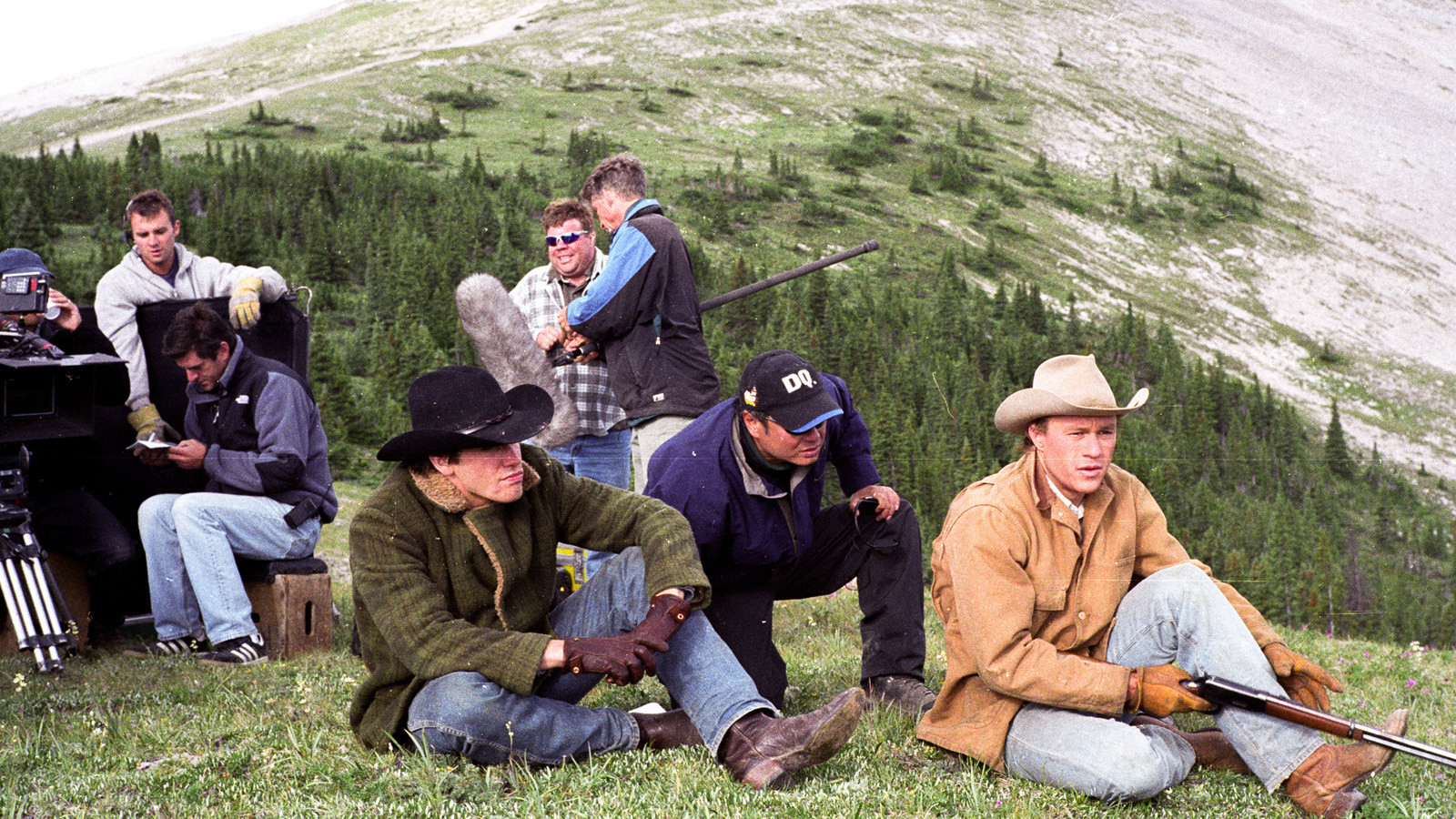 """Jake Gyllenhaal, left, director Ang Lee and Heath Ledger on the set of """"Brokeback Mountain,"""" a Focus Features release."""