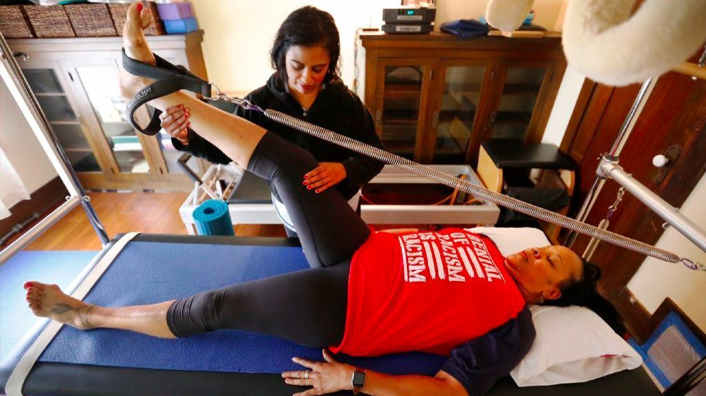 Del Hunter-White, who has lived in Venice since the early '90s, receives therapeutic Pilates conditioning from Rani Vechar, left, to help with her arthritis.