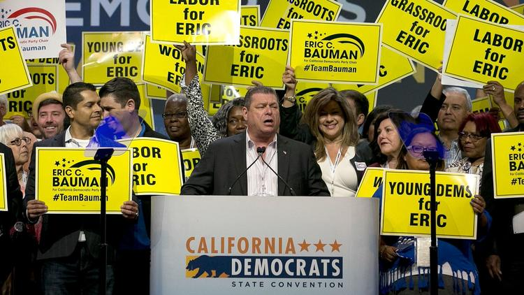 Eric Bauman, center, addresses the California Democratic Party's annual convention in May. (Rich Pedroncelli / Associated Press)