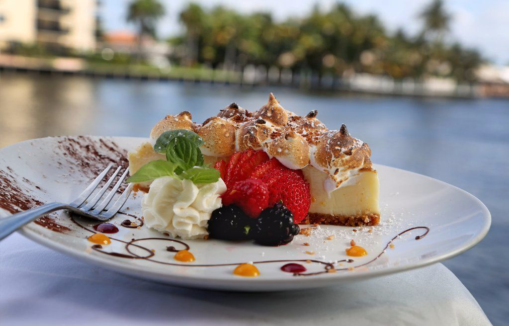 Blue moon 39 s key lime pie topped with meringue sun sentinel for Blue moon fish company menu