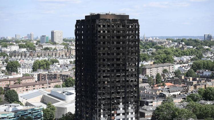 The remains of Grenfell Tower as seen from a neighboring tower block.