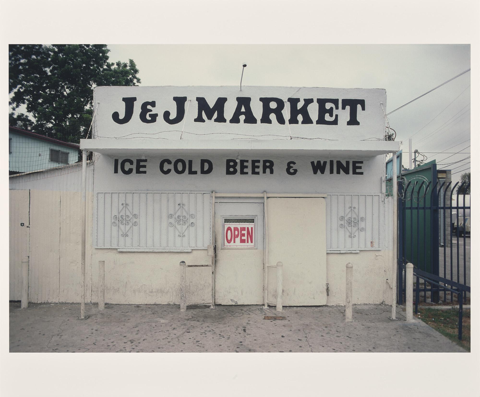 "Camilo José Vergara's ""J.J. Market, Stockwell and Aranbee [sic] Streets, Compton, 2002."""