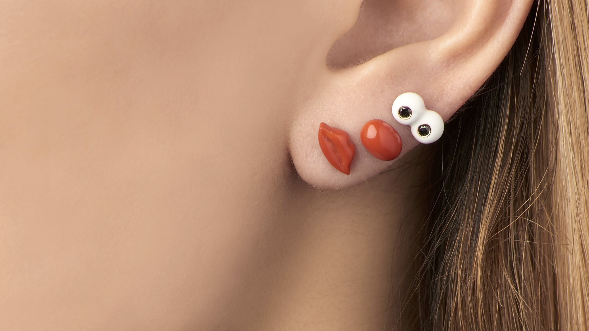 An earring ensemble by Alison Lou, designed for consumers with multiple piercings.