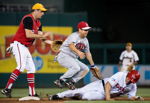 Rep. Raul Ruiz (D-Palm Desert) tags out Rep. Mike Bishop (R-Mich.) at second base as Rep. Tim Ryan (D-Ohio) watches during the annual Congressional Baseball Game. (Bill Clark/CQ Roll Call)