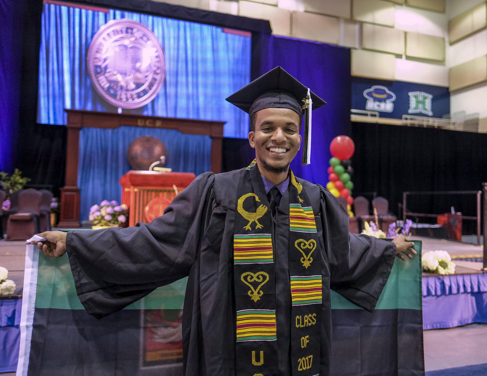 Graduate Alexander Wilson poses in the Black Graduation ceremony at UC Riverside.