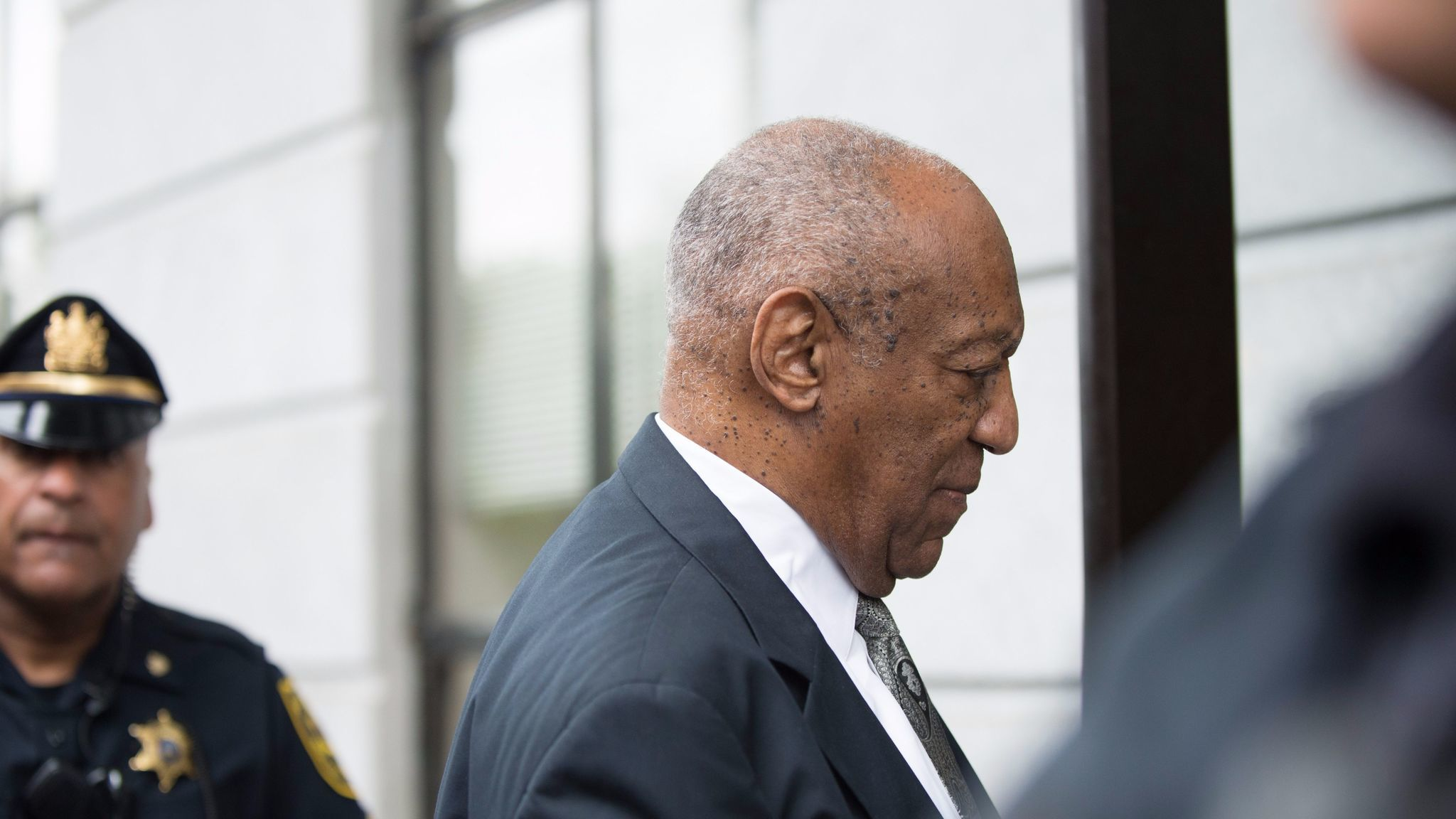 Bill Cosby arrives at the Montgomery County Courthouse for a sixth day of jury deliberations in the trial against him.