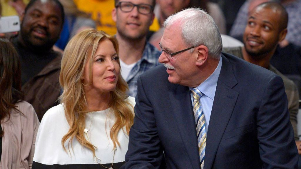 Lakers president Jeanie Buss and former Lakers Coach Phil Jackson during a game against the Mavericks at Staples Center on April 2, 2013.
