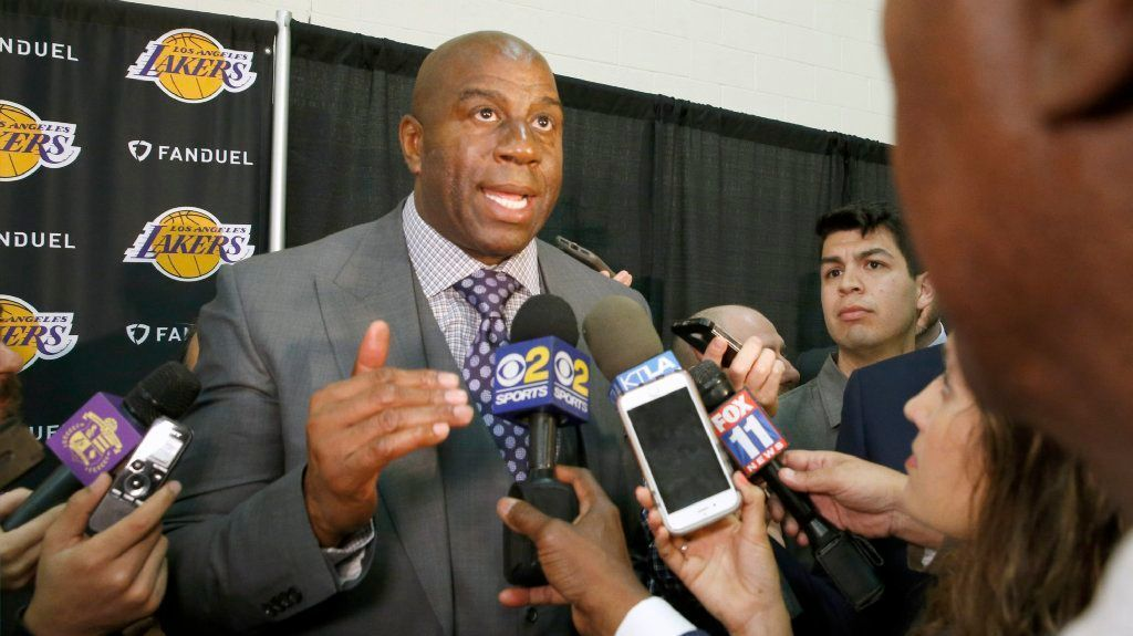 Magic Johnson speaks with members of the media after Rob Pelinka was announced as the new Lakers general manager.