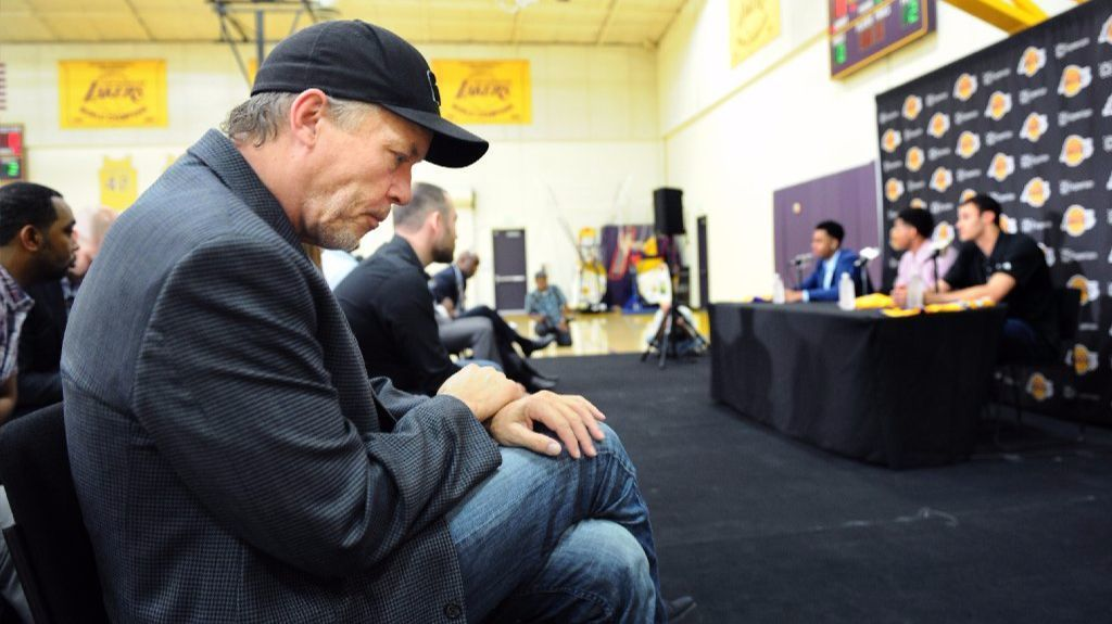 Lakers co-owner Jim Buss listens to draft pick D'Angelo Russell speak to the media during is introduction on June 29, 2015.