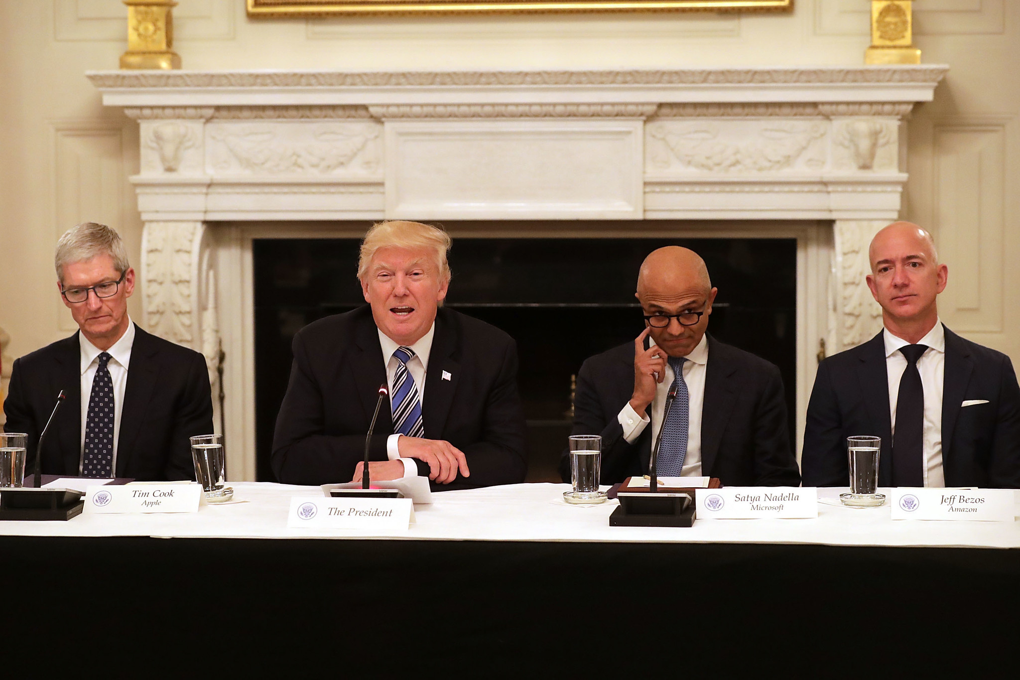 President Trump sits with members of his American Technology Council, from left, Apple CEO Tim Cook, Microsoft CEO Satya Nadella and Amazon CEO Jeff Bezos, at the White House on June 19, 2017. (Chip Somodevilla / Getty Images)