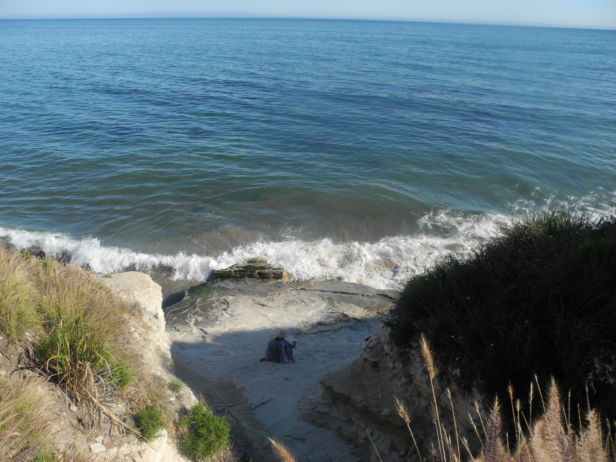 A beachgoer enjoys the water by Aniso Trail between Refugio State Beach and El Capitan State Beach, May 20, 2017.
