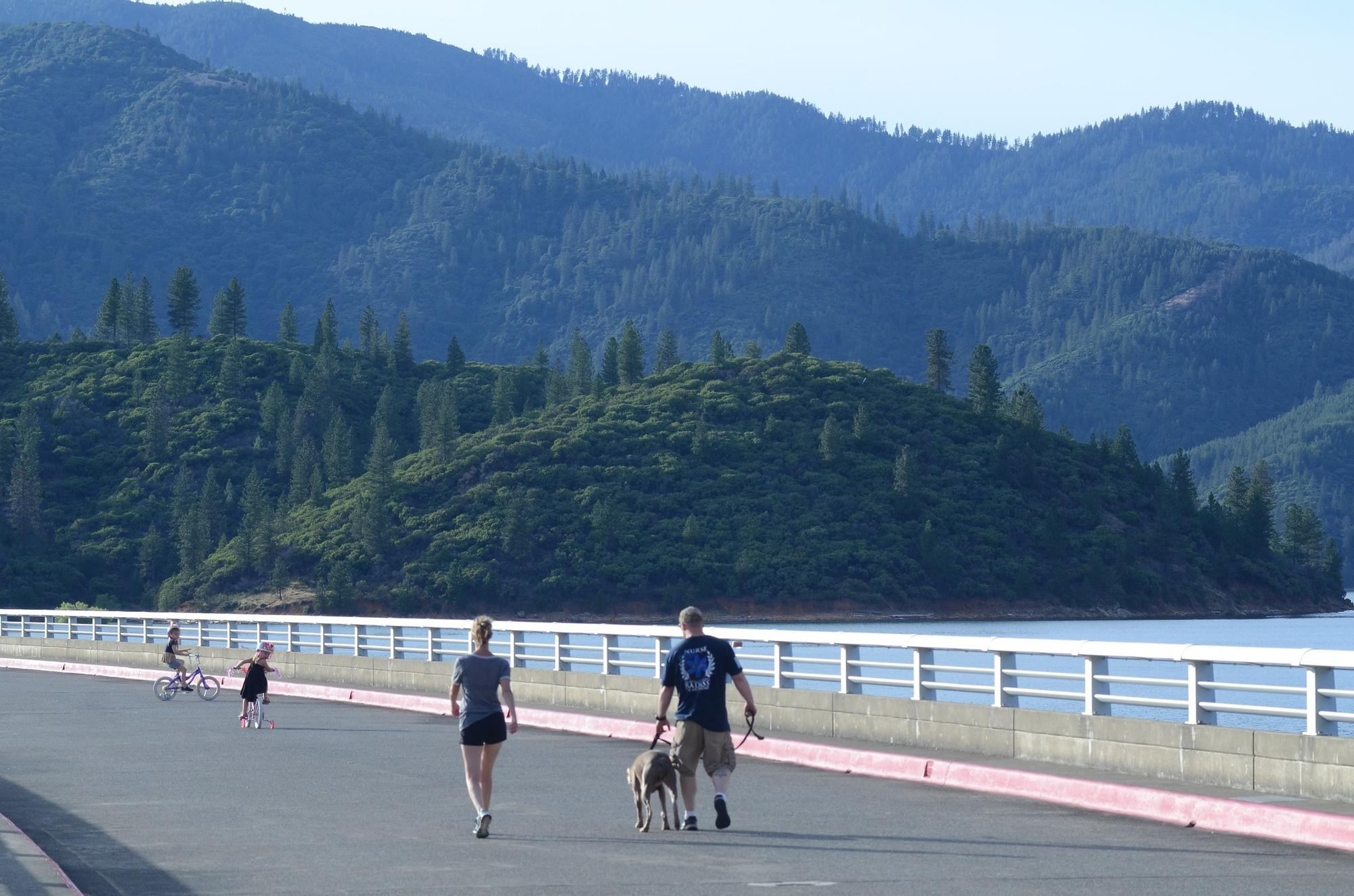 A family strolls atop Shasta Dam, north of Redding, Calif.