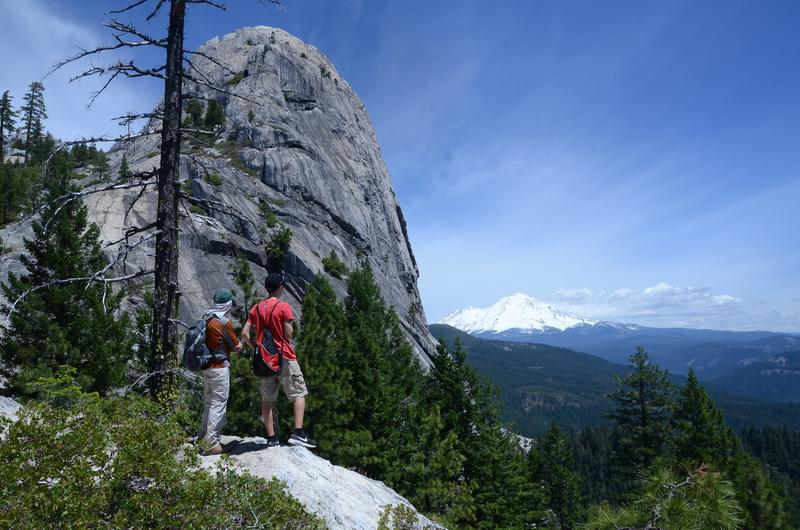 Castle Crags hikers look toward Mt. Shasta. (Christopher Reynolds / Los Angeles Times)