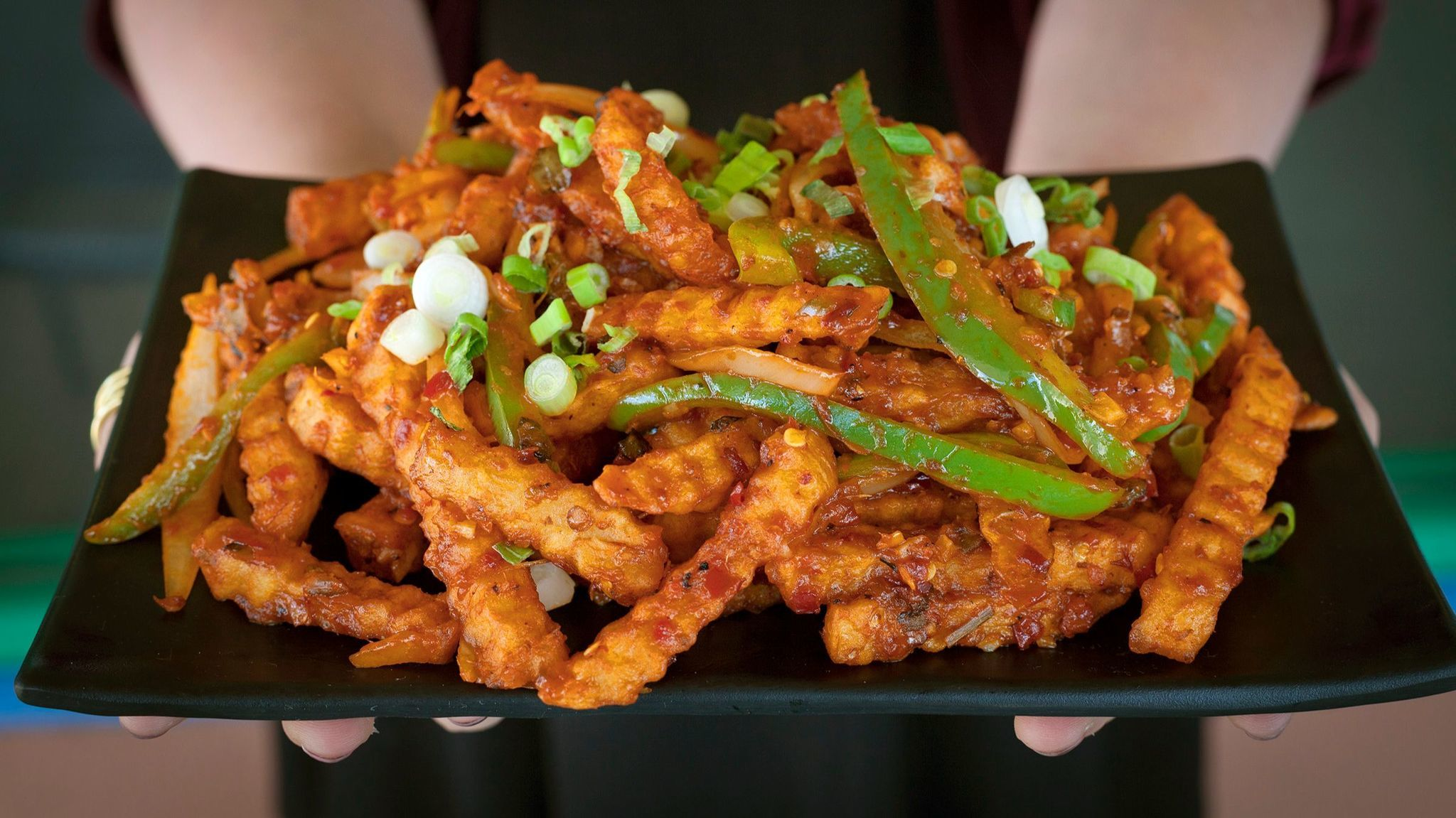 The forkable Szechuan fries at Wok N Tandoor are a delicious example of what happens when Indo-Chinese cuisine lands in O.C.