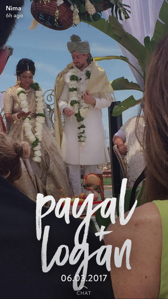 From left, Payal Patel and Logan Lorenz pictured during their wedding in a photo that includes one of the Snapchat geofilters they purchased for the occasion.