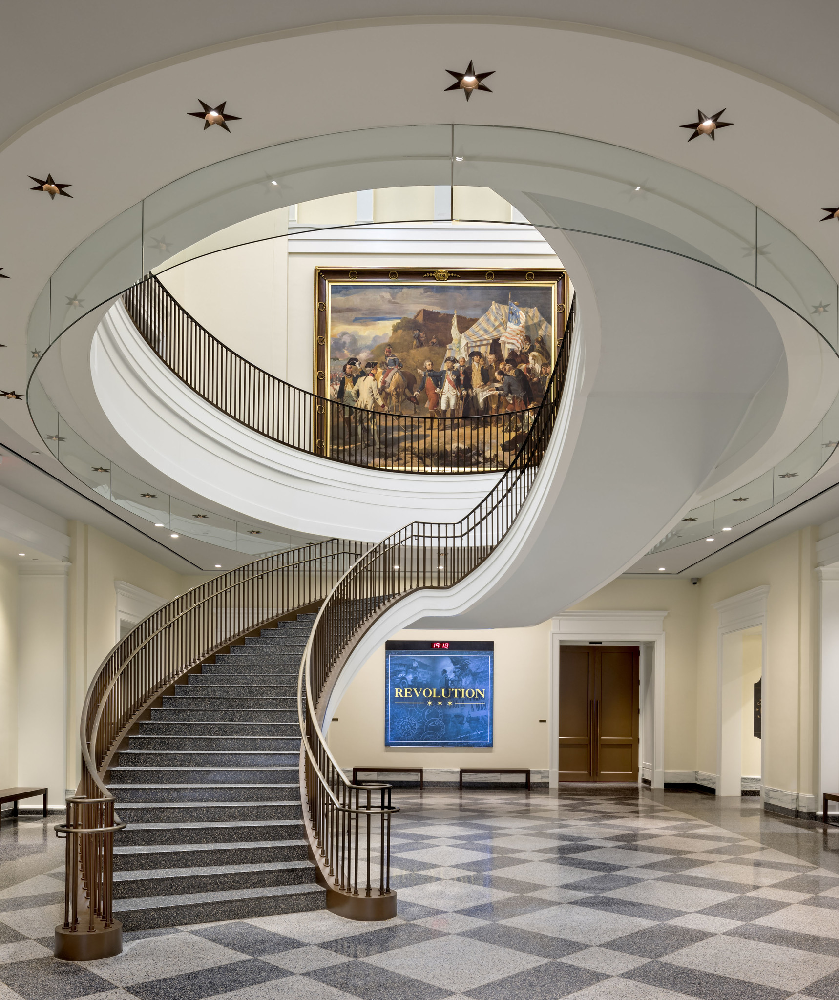 "The museum's atrium is dominated by what the architects call a ""grand elliptical stair."""