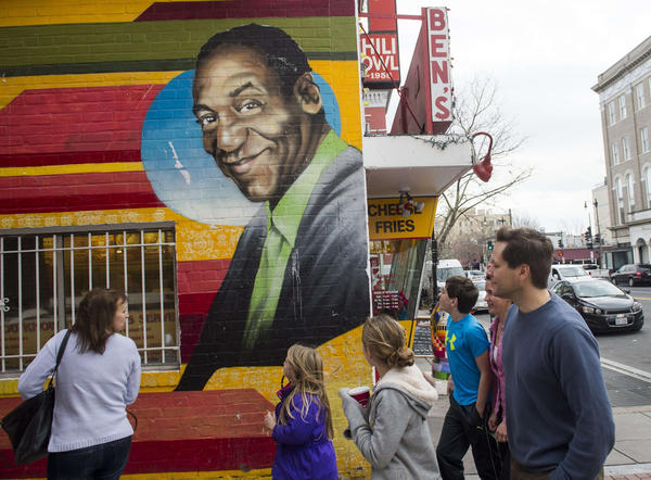 This Ben's Chili Bowl mural featuring comedian Bill Cosby, photographed in 2016, has been removed from the wall of the Washington, D.C., eatery and replaced with images of Barack and Michelle Obama. (Saul Loeb / AFP / Getty Images)