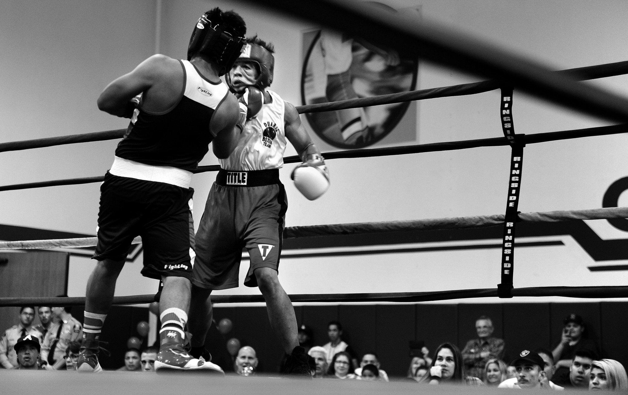 Pat takes a punch in the opening round during his first match as a male boxer at a tournament in Covina.