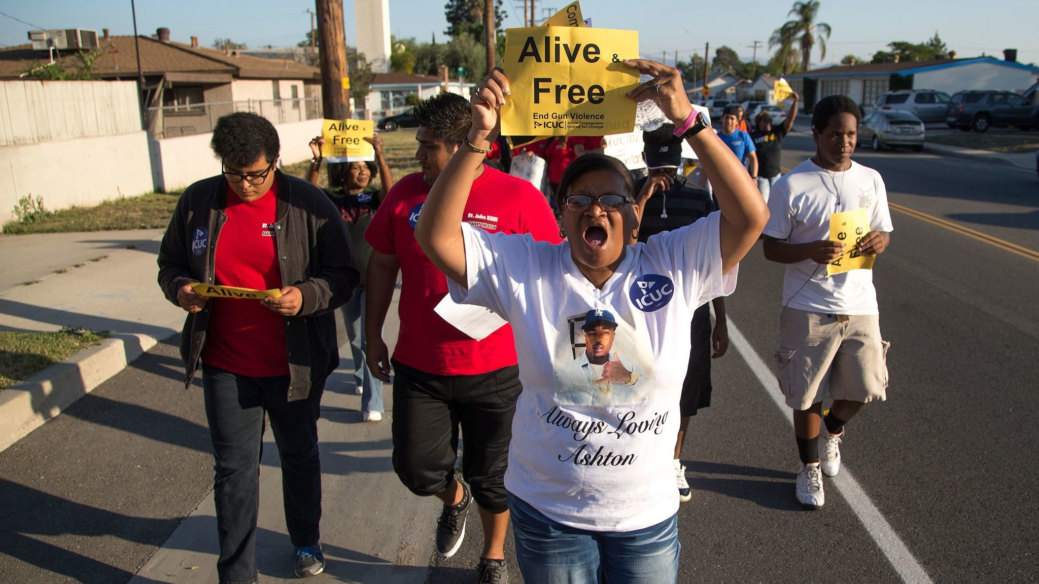 Sandra Hall of San Bernardino marches with about 200 community members in a Peace Walk to honor the victims of homicides and call for an end to gun violence on May 19, 2016, in San Bernardino.