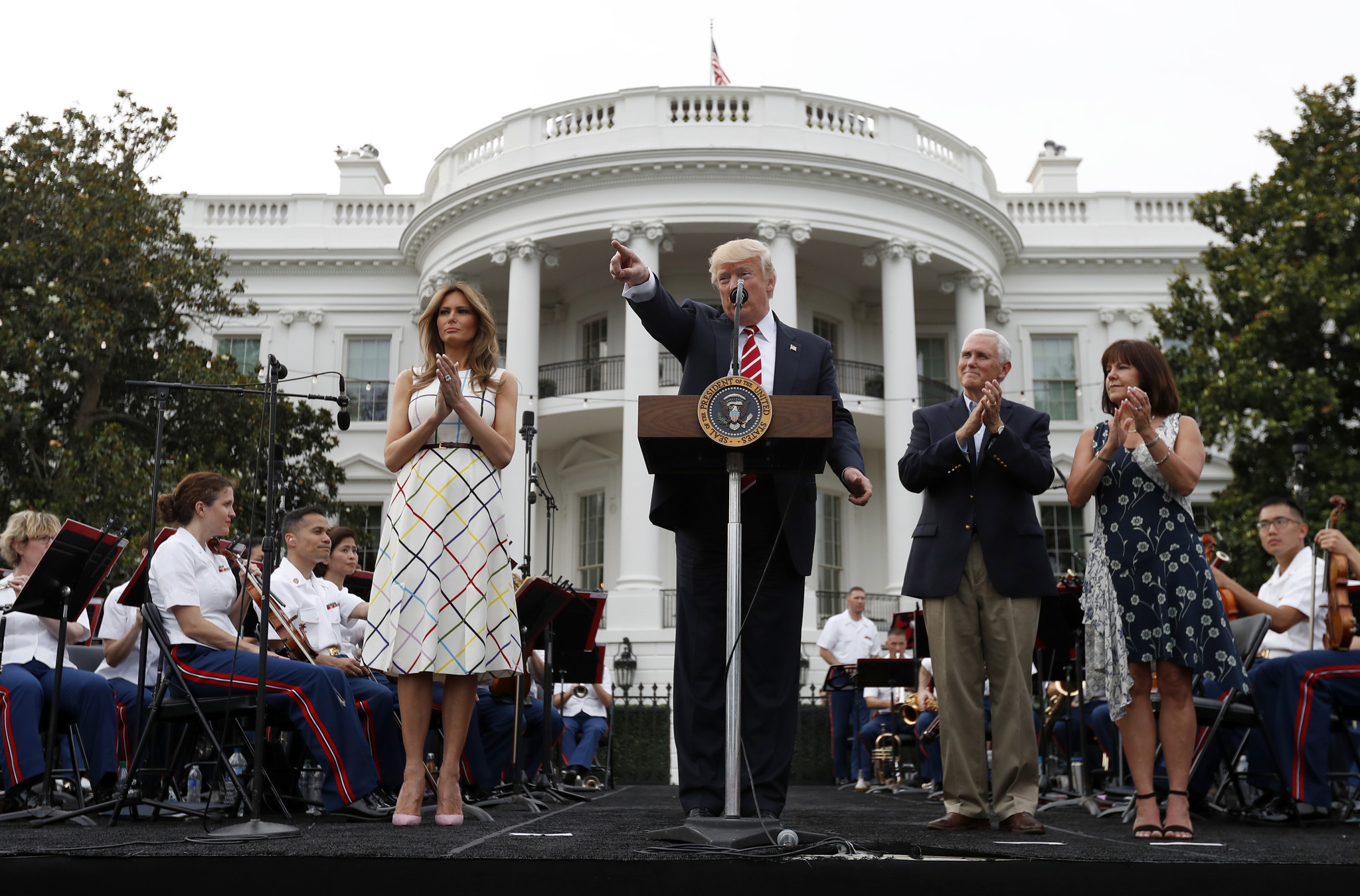President Trump, flanked by First Lady Melania Trump, Vice President Mike Pence and wife Karen Pence, speaks at the congressional picnic at the White House on Thursday, June 22, 2017. (Alex Brandon / Associated Press)