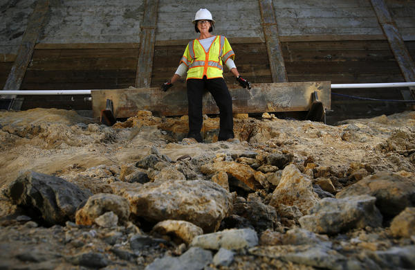 Geologist Rosalind Munro of AMEC, a geotechnical consulting firm, went down a bore hole eight stories deep to determine the stability of the ground at the Wilshire Grand building site. (Mel Melcon / Los Angeles Times)