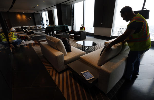 Interior designer Gary Broeker decorates the Presidential suite on the 66th floor of the InterContinental Los Angeles Downtown hotel at the Wilshire Grand Center. (Mel Melcon/Los Angeles Times)