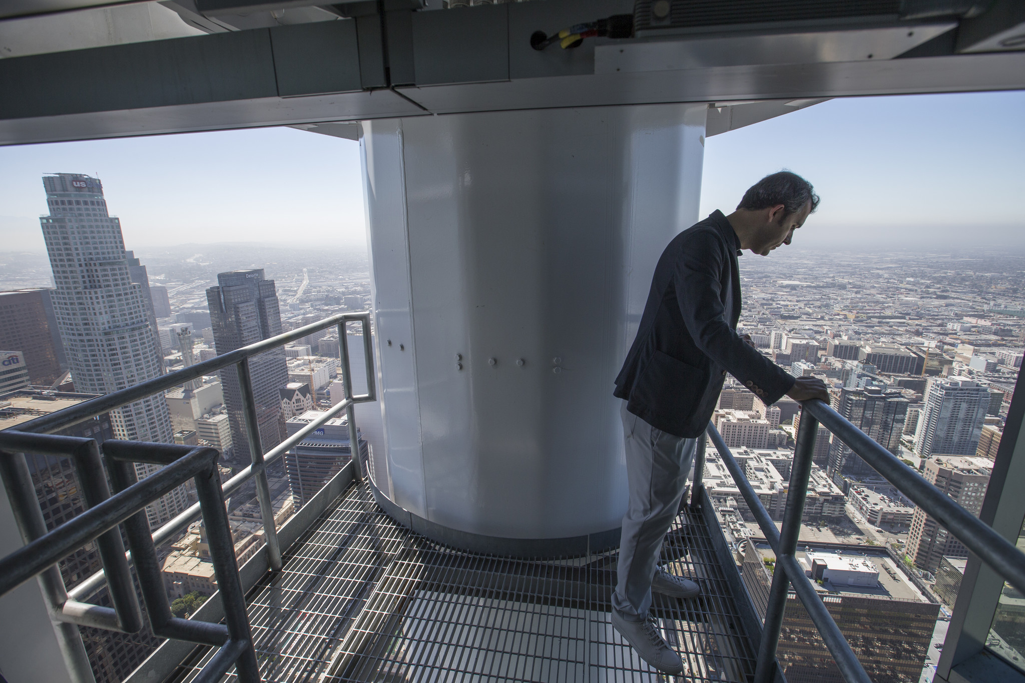 Brad Gwinn, StandardVision chief operations officer, looks out from inside the sail atop of the InterContinental Los Angeles bar on the 73rd floor of the Wilshire Grand Center.