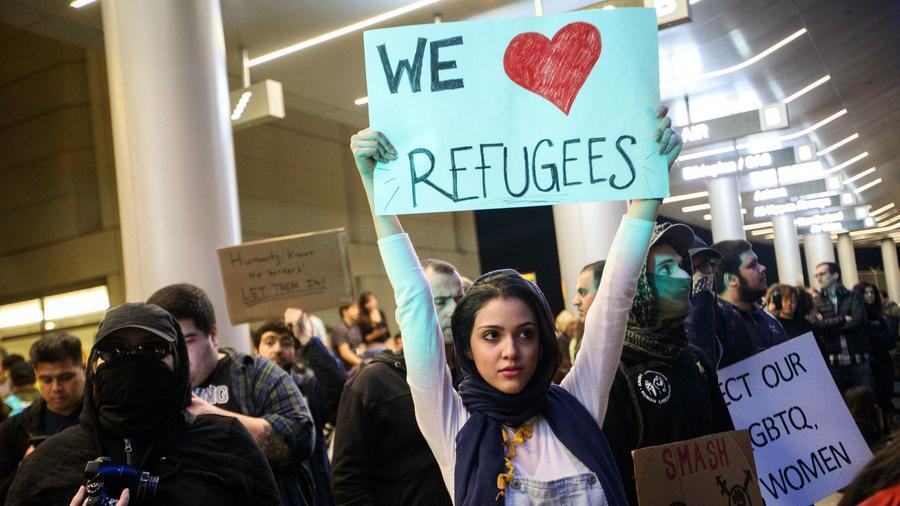 REFUGEES TO US CUT IN HALF