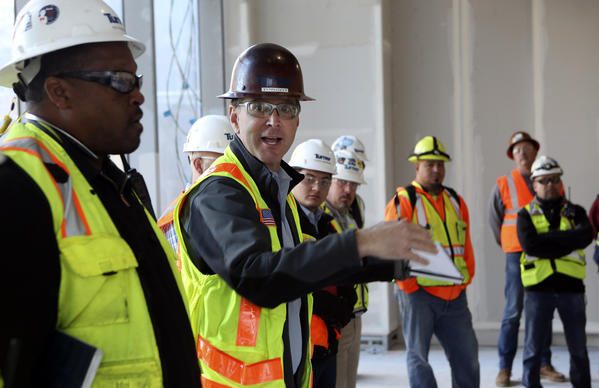 Marc Turcot, second from left, tower superintendent, meets with foremen during their daily meeting March 9. (Mel Melcon / Los Angeles Times)