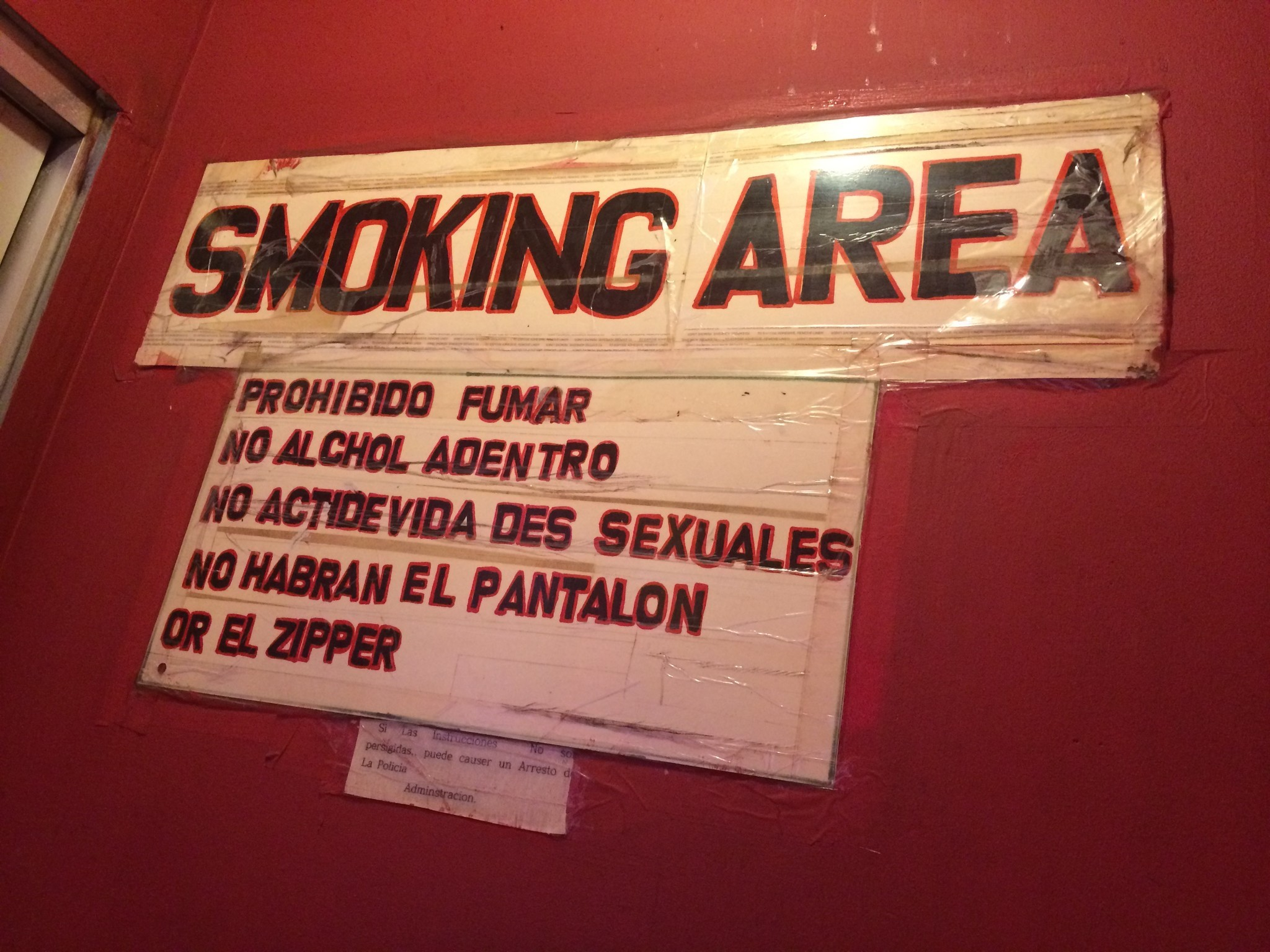 A sign in crude Spanish at the Tiki advises patrons to keep it zipped.