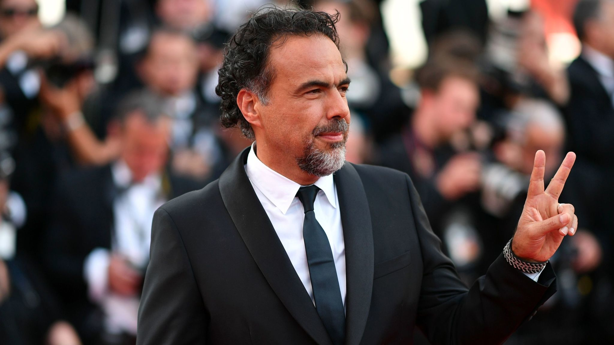 "Alejandro G. Iñárritu arrives for a screening of his virtual reality experience ""Carne y Arena"" at Cannes in May."